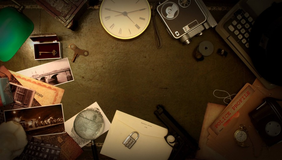 Assorted clues for an escape room: clock, fingerprints, photos, lock, and more